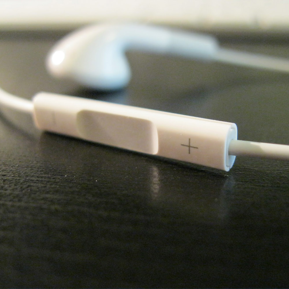 The remote on a set of Apple Earbuds.