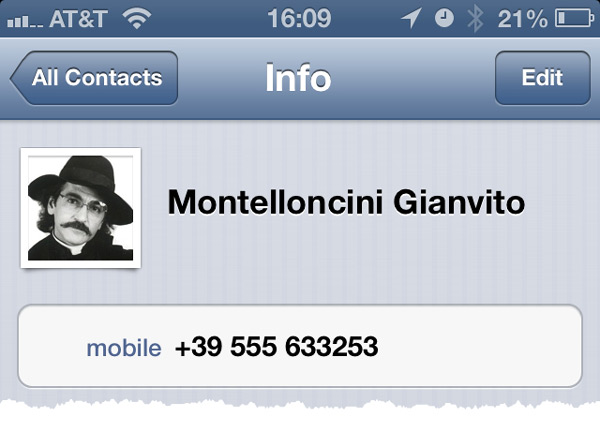 An iPhone screen shows a typical record in the Contacts app.