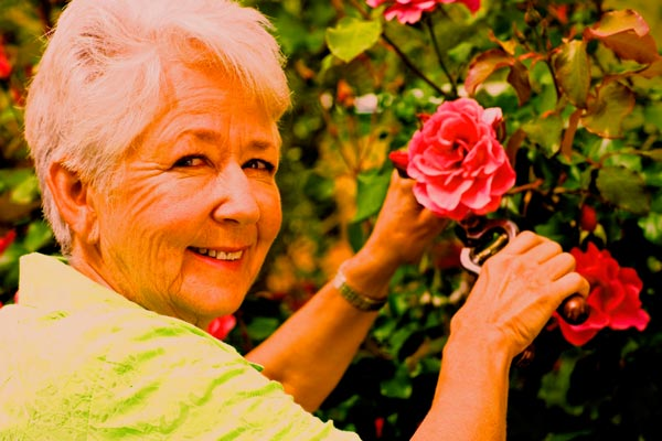 Over-saturated photo of a lady with flowers