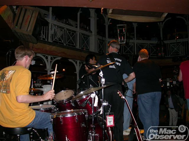 The band from the back, including a price tag on the cymbal stand, and a great shirt on Duane.