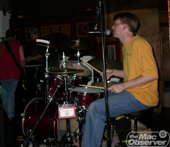 Dave on drums, with Bob and Chris in the background.