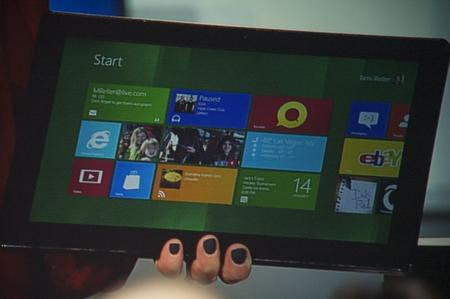 Tami Reller shows off ger black finger nail polish and a Windows 8 Metro tablet.