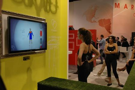 This beautiful booth model was trying on clothes, virtually, using hand gestures and body movements.