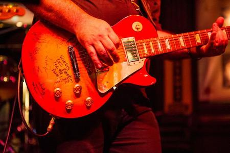 John Welch organized a thank-you present for Paul in the form of this Les Paul. It was signed by the contributors, and Paul play