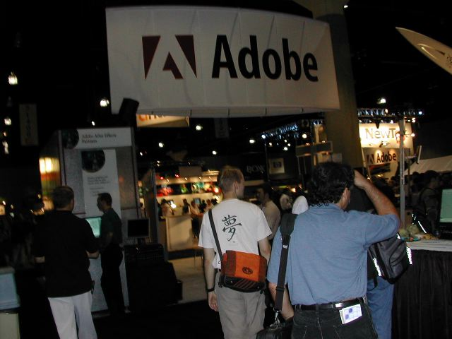 People head toward the Adobe booth.