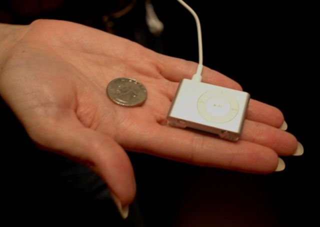 iPod shuffle isn't bigger than a quarter.