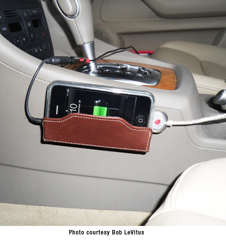 brown mobi in Audi with cables