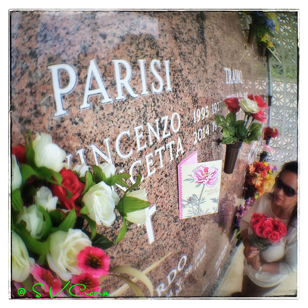 A photo of a woman at a cemetery. Shot with the Olloclip fisheye attachment