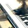 Firefighters work to contain a blaze at Apple's Mesa, AZ former sapphire factory