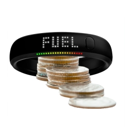 Nike FuelBand with coins. Nike FuelBand settlement value is in education, not money.
