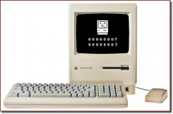"A Macintosh Plus with an ""Sad Mac"" error screen"