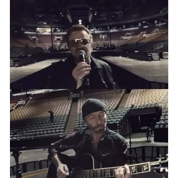 Bono and The Edge playing