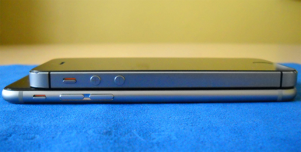 The iPhone 6 (bottom) is thinner and longer than the iPhone 5s (top)