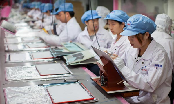 Chinese Workers Making Apple Laptops