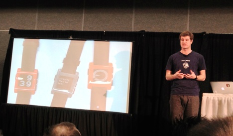 Pebble's Eric Migicovsky shows off the company's smartwatch at CES