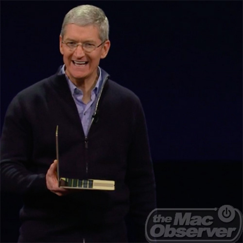 Apple CEO Tim Cook shows off gold MacBook