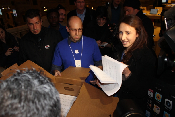Petitions being handed over to Apple employees
