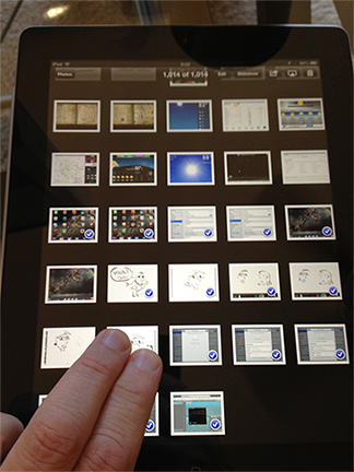 Tap and swipe with two fingers to quickly select multiple pics in Photos on the iPad