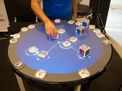 Reactable Live! device with acrylic modules on its touch-sensitive surface.