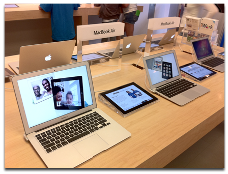 iPad kiosk and MacBook Air