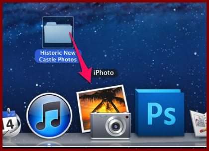 Drag-and-drop the folder to the iPhoto icon in the dock