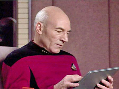 Captain Jean-Luc Picard with his iPad on the bridge of the U.S.S. Enterprise.
