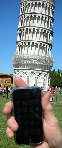An iPhone poised to photograph the leaning tower of Pisa.