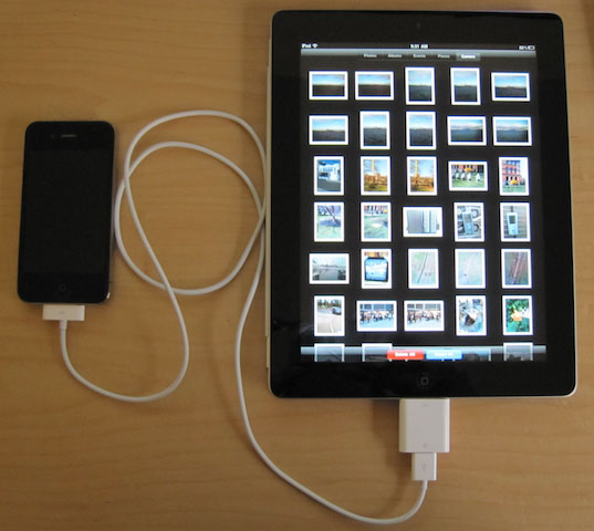 An iPhone connected via cable to an iPad.