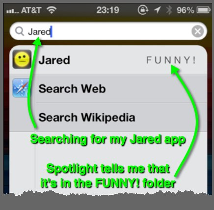 Searching for an app in the Spotlight search screen on an iPhone.