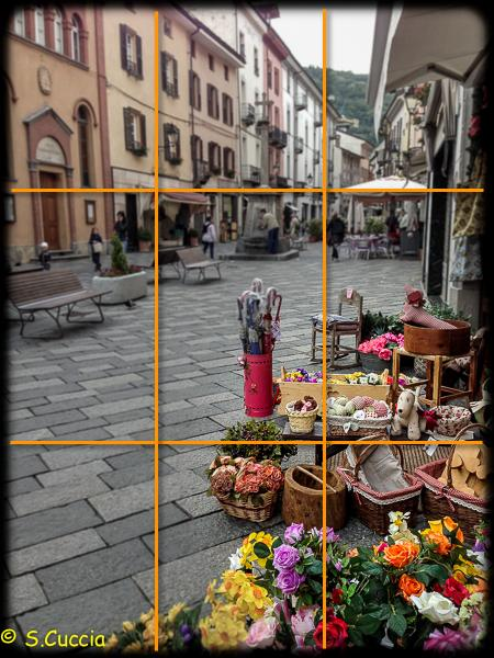 An iPhone image of a street in Italy. A tic-tac-toe grid is superimposed to help with composition.