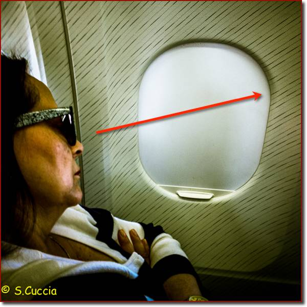 An iPhone image of a nice lady napping on a plane