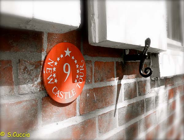 Photo of a red sign under a window