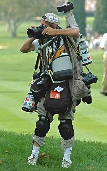 Photographer laden down with lots of camera gear
