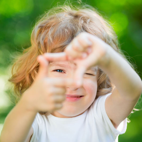Little girl composing a photo with her fingers