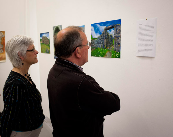 Two people examining a photograph