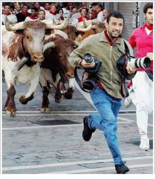 A photographer running with the bulls in Pamplona Spain