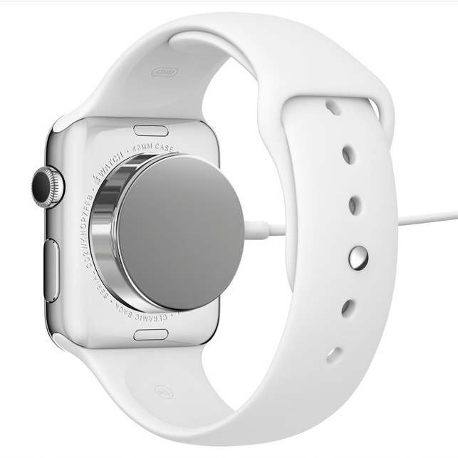 Apple Watch with magnetic induction charging cable attached.