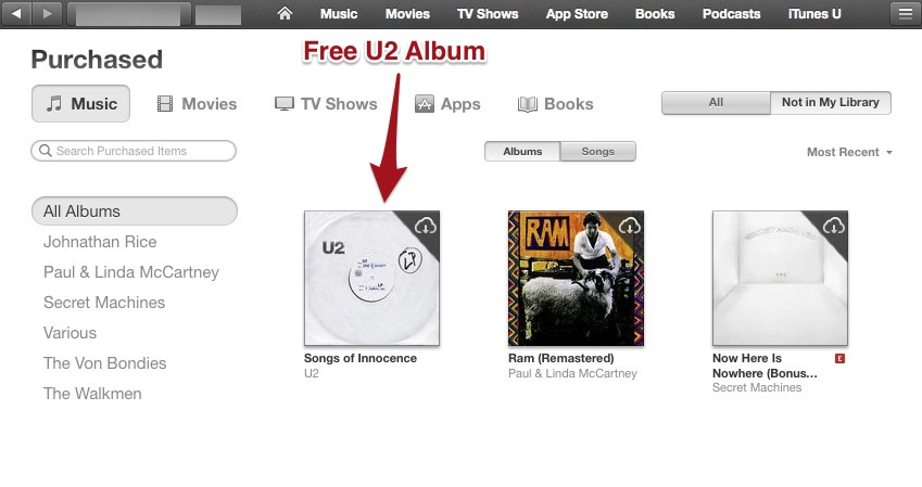 iTunes showing Songs of Innocence available for download.