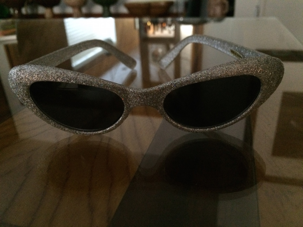 A sparkly silver pair of sunglasses