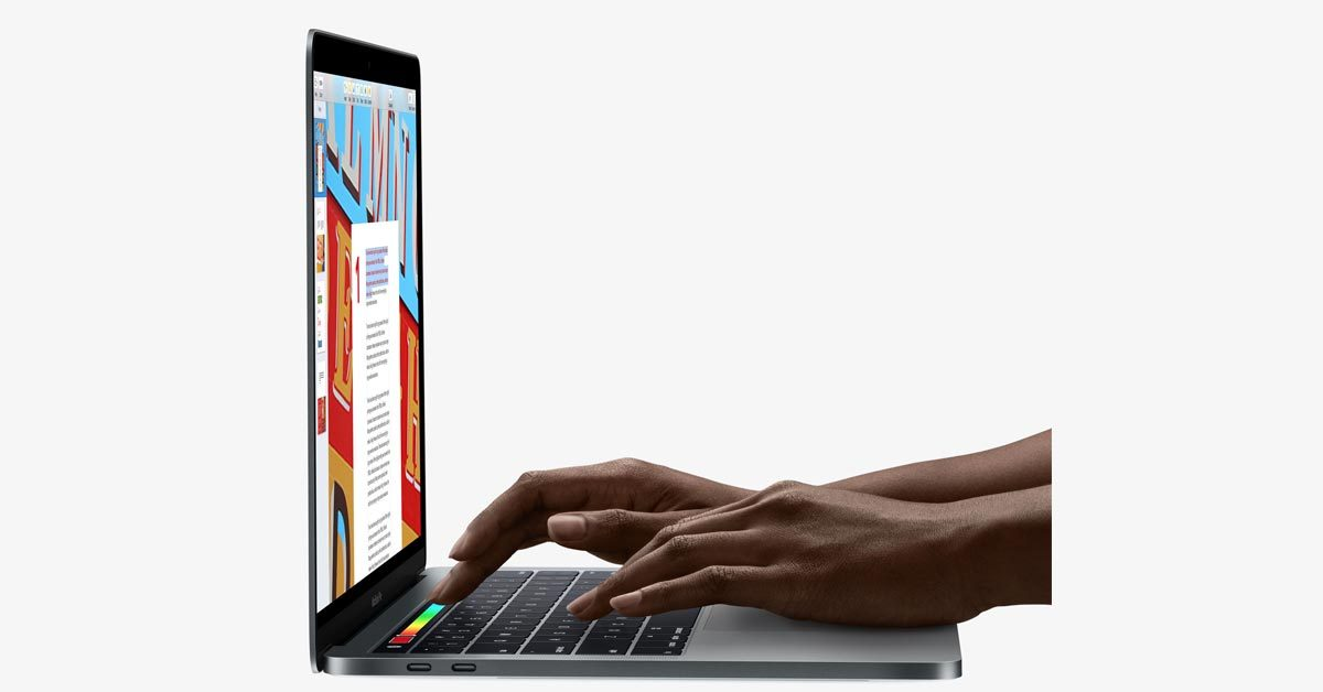 A woman using Touch Bar on MacBook Pro