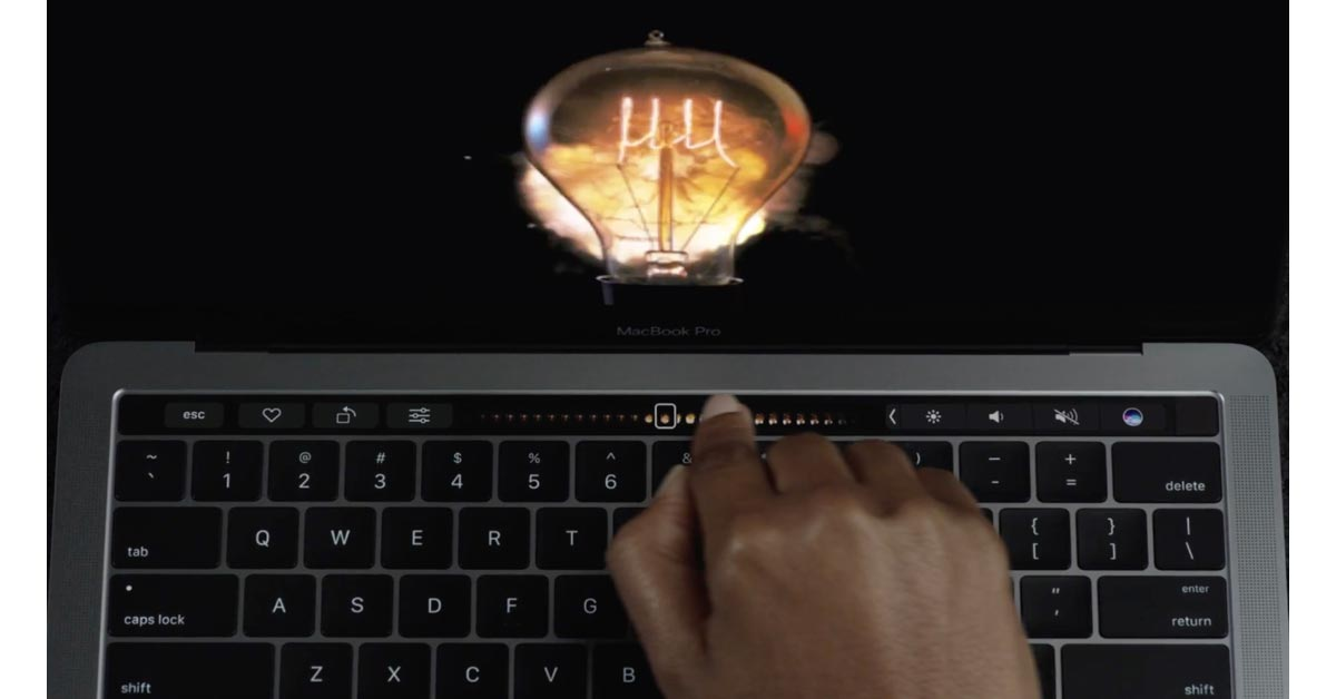 "Woman using Touch Bar to scrub through video from Apple's ""Bulbs"" commercial"