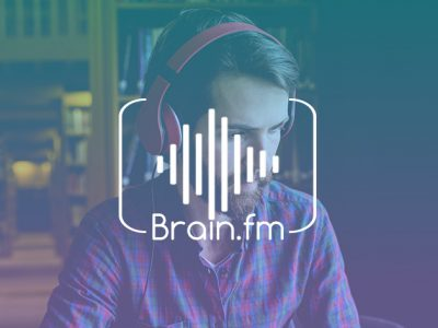 Brain.fm logo and man listening on headphones