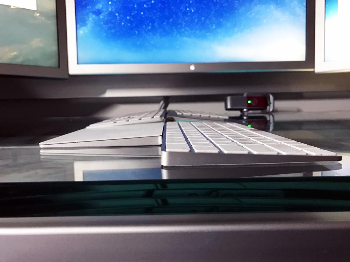 A photograph showing the Matias Wireless Keyboard side by side with Apple's Magic Trackpad