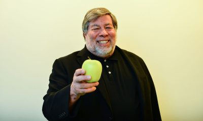 Steve Wozniak holding an apple