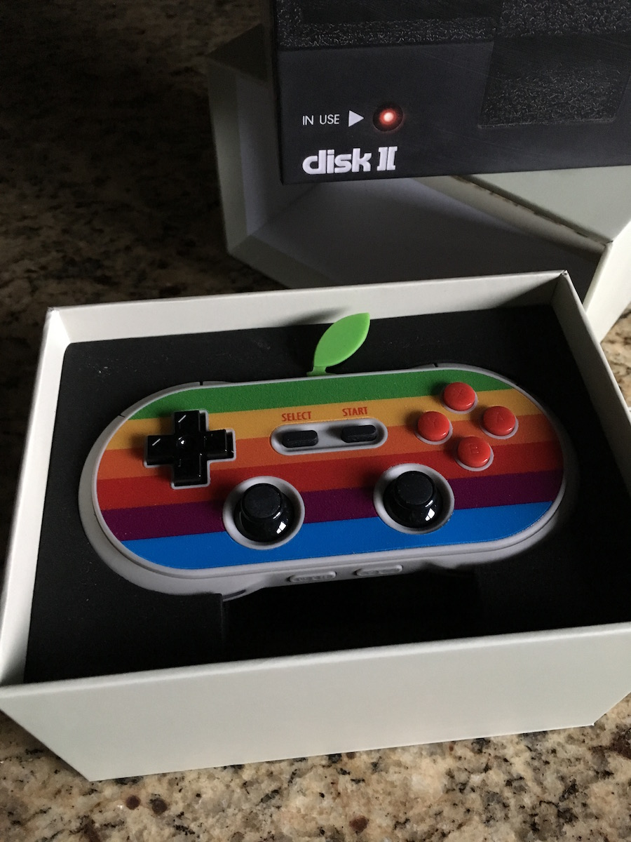 Image of the limited edition 8Bitdo controller with old Apple logo stripes