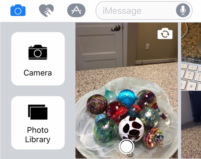 The extra camera options in Messages on the iPhone give you a full screen camera view and access to your whole Photos library