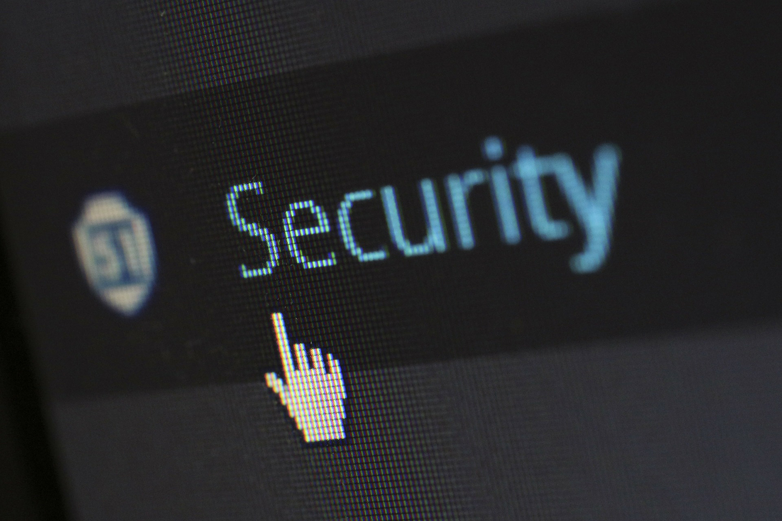 Image of mouse pointer clicking on a security button. Apple's differential privacy might be less private than we think.