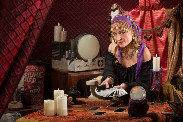 Gypsy Fortunetellerhttps://thumb1.shutterstock.com/display_pic_with_logo/102804/140873320/stock-photo-smiling-gypsy-soothsayer-with-hand-of-tarot-cards-140873320.jpg