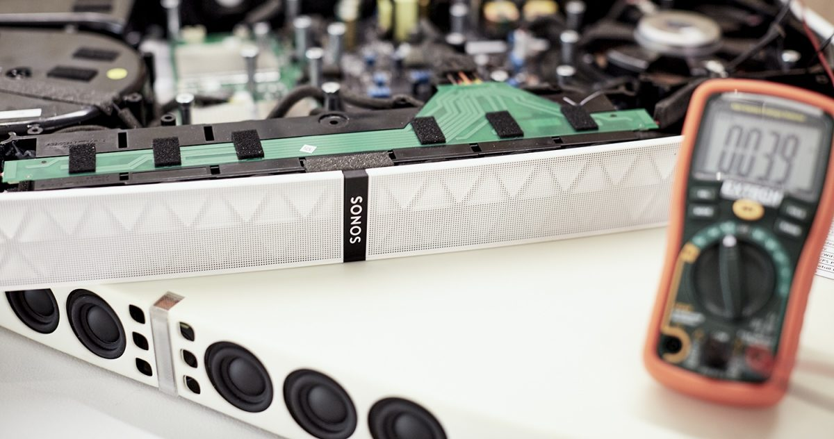 a Sonos Playbase opened up to show the internals and speaker array