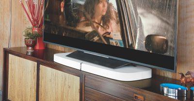 Sonos white PLAYBASE underneath TV